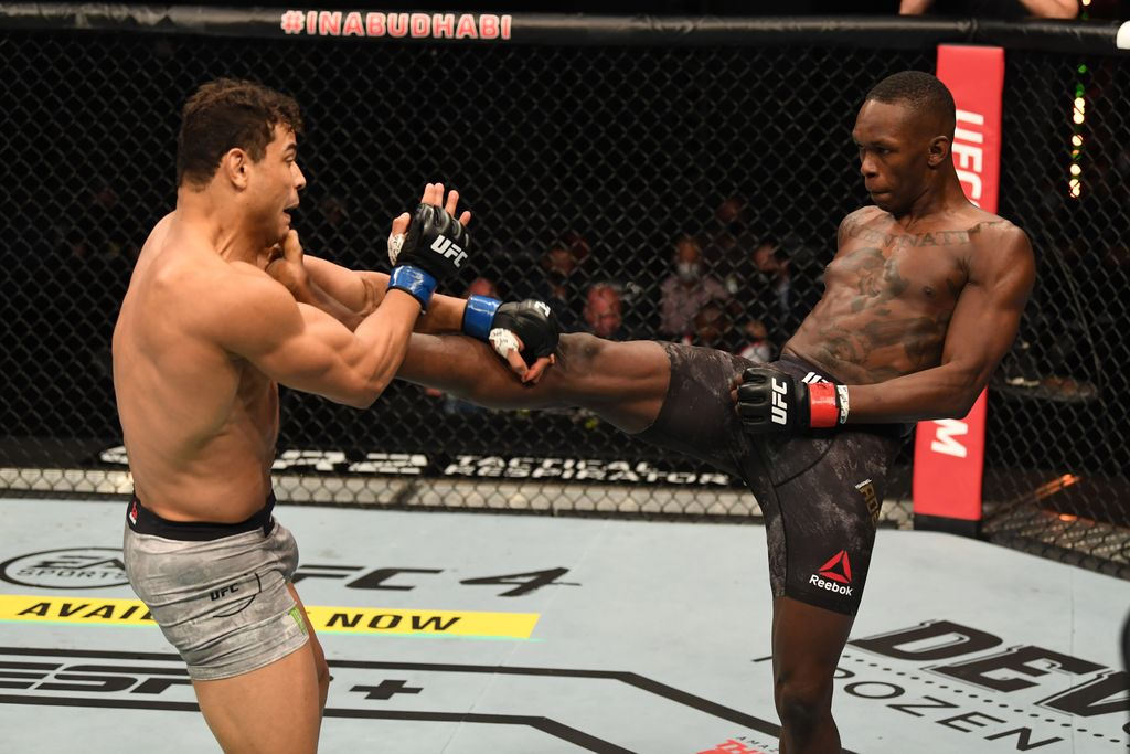 MELBOURNE, AUSTRALIA - OCTOBER 06: Israel Adesanya celebrates his victory over Robert Whittaker between in their Middleweight title bout  during UFC 243 at Marvel Stadium on October 06, 2019 in Melbourne, Australia. (Photo by Darrian Traynor/Getty Images)