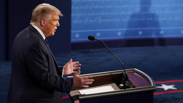 President Donald Trump answers a question during the first presidential debate Tuesday, Sept. 29, 2020, at Case Western University and Cleveland Clinic, in Cleveland, Ohio. (AP Photo/Morry Gash, Pool)