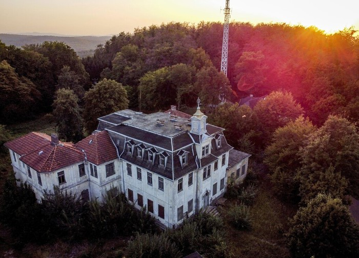 A wrecked and abandoned villa built in 1900 stands in a forest near Eisenach, eastern Germany, Monday, Sept. 21, 2020. Thirty years after Germany was reunited on Oct. 3, 1990, many once-decrepit city centers in the formerly communist east have been painstakingly restored and new factories have sprung up. But many companies and facilities didn't survive the abrupt transition to capitalism. (AP Photo/Michael Probst)