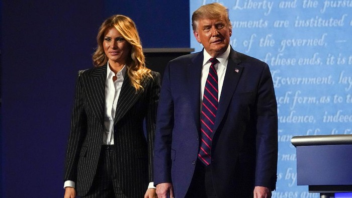 President Donald Trump and first lady Melania Trump walks off stage at the end of the first presidential debate Tuesday, Sept. 29, 2020, at Case Western University and Cleveland Clinic, in Cleveland, Ohio. (AP Photo/Julio Cortez)
