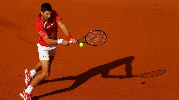 PARIS, FRANCE - OCTOBER 01: Novak Djokovic of Serbia plays a backhand during his Mens Singles second round match against Ricardas Berankis of Lithuania on day five of the 2020 French Open at Roland Garros on October 01, 2020 in Paris, France. (Photo by Julian Finney/Getty Images)