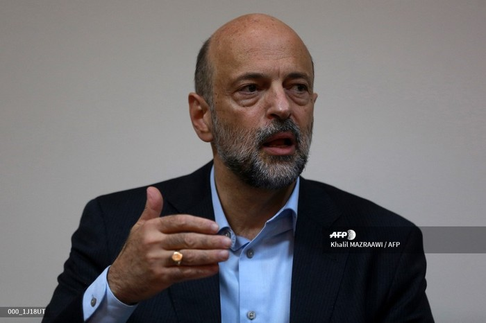 Jordans Prime Minister Omar al-Razzaz gives a press conference in the southern port city of Aqaba on July 23, 2019, discussing projects in the area including an underwater military museum. (Photo by Khalil MAZRAAWI / AFP)