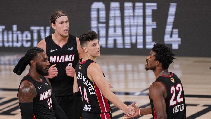 Miami Heats Tyler Herro, center, high fives Jimmy Butler (22) along with Kelly Olynyk, top left, and Jae Crowder, left, after a win against Los Angeles Lakers 115-104 after Game 3 of basketballs NBA Finals, Sunday, Oct. 4, 2020, in Lake Buena Vista, Fla. (AP Photo/Mark J. Terrill)
