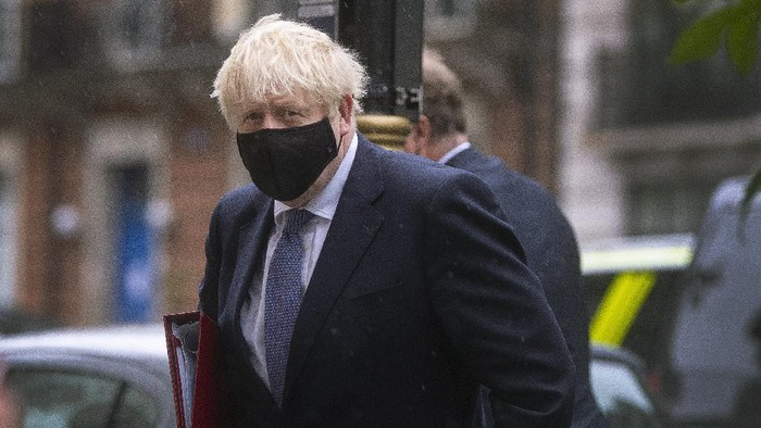 """Britains Prime Minister Boris Johnson arrives at BBC Broadcasting House to appear on the Andrew Marr show, in London, Sunday, Oct. 4, 2020.  Johnson has defended his handling of the coronavirus pandemic, but warned that the country faces a """"bumpy"""" winter ahead. Britain has Europe's highest coronavirus death toll, at more than 42,000, and Johnson's Conservative government is facing criticism from all sides. Opponents say tougher social restrictions are needed to suppress a second pandemic wave. (Victoria Jones/PA via AP)"""