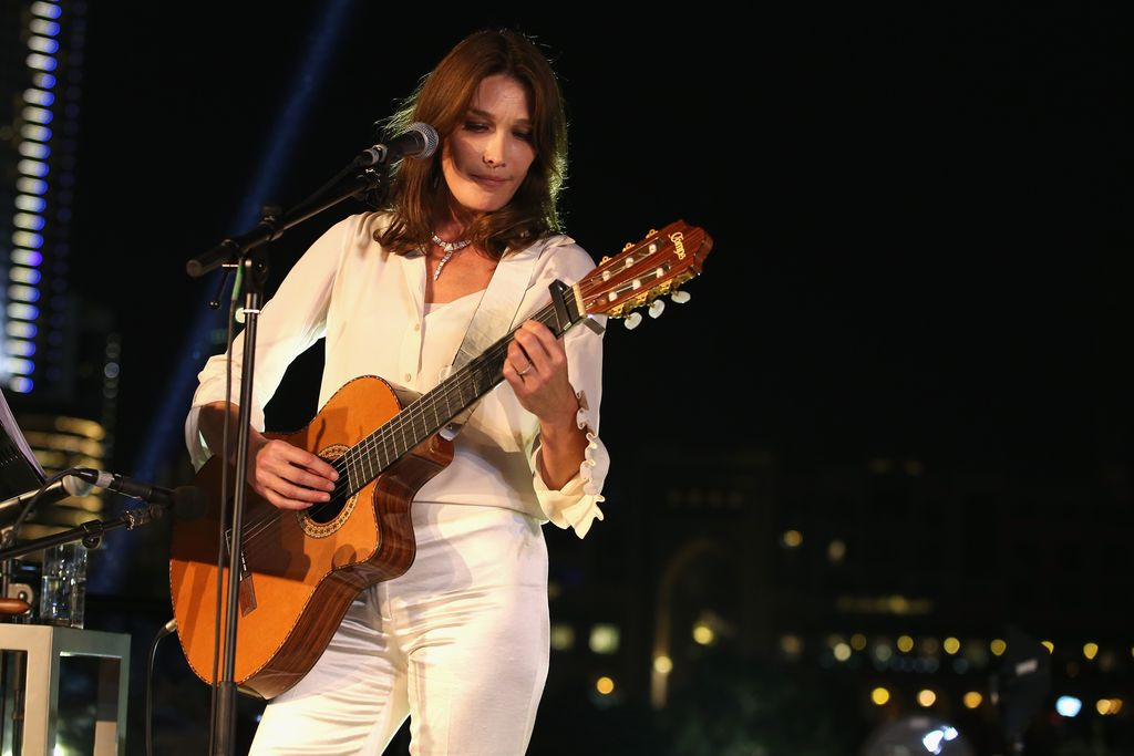 DUBAI, UNITED ARAB EMIRATES - OCTOBER 30:  Carla Bruni performs live at the Gala event during the Vogue Fashion Dubai Experience 2015 at Armani Hotel Dubai on October 30, 2015 in Dubai, United Arab Emirates.  (Photo by Luca Teuchmann/Getty Images for Vogue and The Dubai Mall)