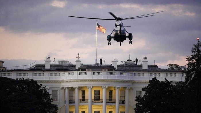 President Donald Trump arrives back at the White House aboard Marine One, Monday evening, Oct. 5, 2020 in Washington, after being treated for COVID-19 at Walter Reed National Military Medical Center. The presidents personal physician, Dr. Sean Conley, told reporters on Monday afternoon that Trump is not out of the woods yet, but that there is no care at the hospital that the president cannot get at the White House. (AP Photo/J. Scott Applewhite)
