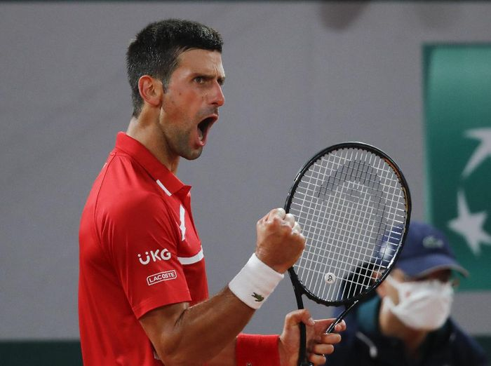 Serbias Novak Djokovic clenches his fist after scoring a point against Russias Karen Khachanov in the fourth round match of the French Open tennis tournament at the Roland Garros stadium in Paris, France, Monday, Oct. 5, 2020. (AP Photo/Christophe Ena)