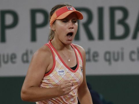 Sofia Kenin of the U.S. clenches her fist after scoring a point against Romania's Ana Bogdan in the second round match of the French Open tennis tournament at the Roland Garros stadium in Paris, France, Thursday, Oct. 1, 2020. (AP Photo/Alessandra Tarantino)