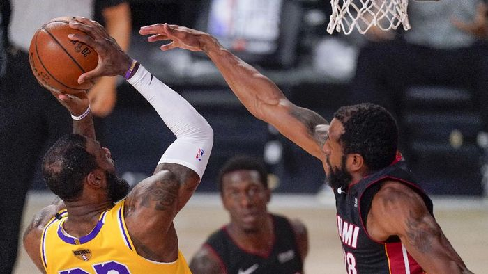 Los Angeles Lakers forward LeBron James shoots over Miami Heat guard Andre Iguodala during the first half in Game 4 of basketballs NBA Finals Tuesday, Oct. 6, 2020, in Lake Buena Vista, Fla. (AP Photo/Mark J. Terrill)