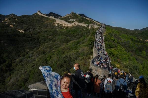 Warga China kini tengah menikmati musim liburan yang disebut Golden Week selama periode liburan delapan hari. Kevin Frayer/Getty Images