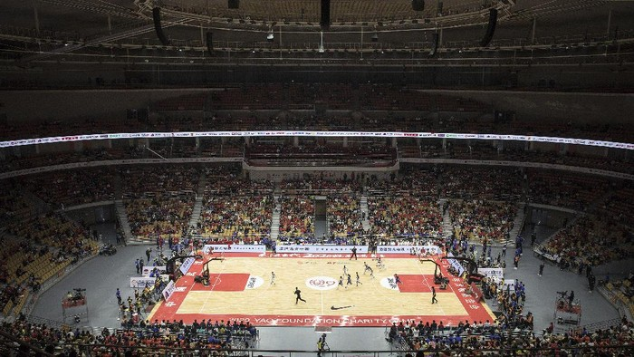 WUHAN, CHINA - OCTOBER 04:Thousands of fans during 2020 Yao Foundation Charity tournament on October 4, 2020 in Wuhan, Hubei province, China.The tournament pits a Chinese basketball star team and against Male Dingle Star team, coached by Du Feng and Stephon Marbury respectively. China is celebrating its national day from October 1 to 8, marking the 71st anniversary of the founding of the Peoples Republic of China. As there have been no recorded cases of community transmission in Wuhan since May, life for residents is gradually returning to normal. (Photo by Getty Images)