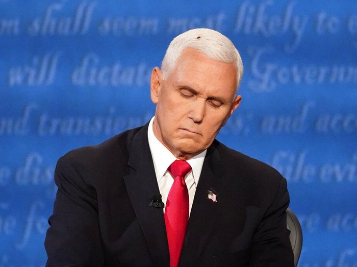 Vice President Mike Pence listens to Democratic vice presidential candidate Sen. Kamala Harris, D-Calif., during the vice presidential debate Wednesday, Oct. 7, 2020, at Kingsbury Hall on the campus of the University of Utah in Salt Lake City. (AP Photo/Julio Cortez)