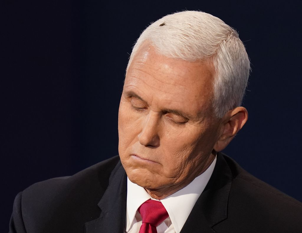 Vice President Mike Pence listens to Democratic vice presidential candidate Sen. Kamala Harris, D-Calif., during the vice presidential debate Wednesday, Oct. 7, 2020, at Kingsbury Hall on the campus of the University of Utah in Salt Lake City. (AP Photo/Patrick Semansky)