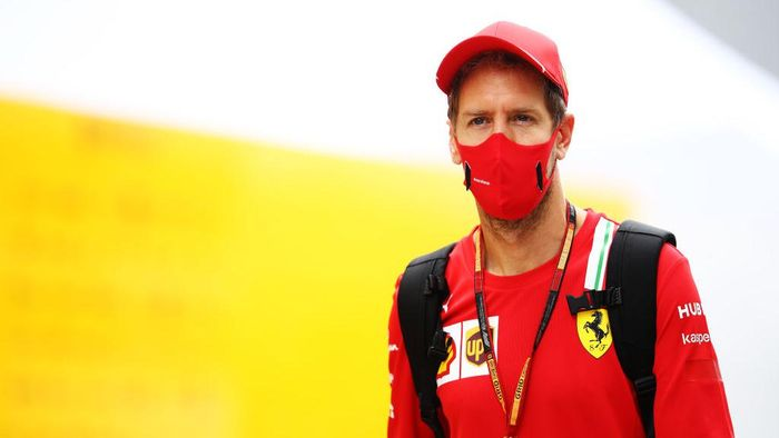 SOCHI, RUSSIA - SEPTEMBER 26: Sebastian Vettel of Germany and Ferrari walks in the Paddock before final practice ahead of the F1 Grand Prix of Russia at Sochi Autodrom on September 26, 2020 in Sochi, Russia. (Photo by Mark Thompson/Getty Images)