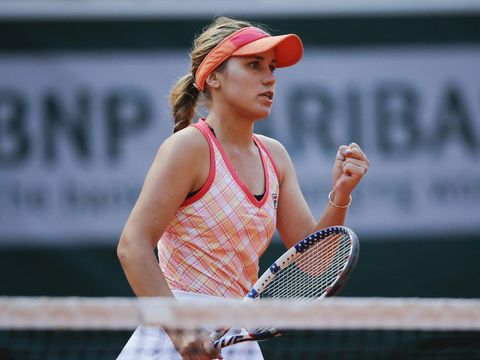 Sofia Kenin of the U.S. clenches her fist after scoring a point against Danielle Collins of the U.S. in the quarterfinal match of the French Open tennis tournament at the Roland Garros stadium in Paris, France, Wednesday, Oct. 7, 2020. (AP Photo/Christophe Ena)