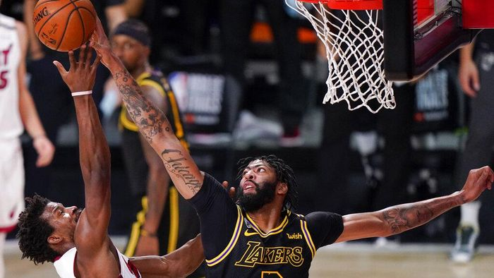 Los Angeles Lakers forward Anthony Davis, blocks a shot by Miami Heat forward Jimmy Butler during the first half in Game 5 of basketballs NBA Finals Friday, Oct. 9, 2020, in Lake Buena Vista, Fla. (AP Photo/Mark J. Terrill)