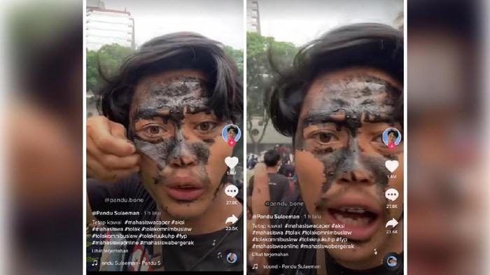 Pria ini menggunakan masker kecantikan saat aksi demo RUU cipta kerja
