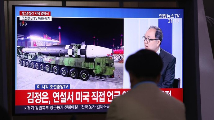 """This image made from video broadcasted by North Koreas KRT, shows a military parade with what appears to be a possible new solid-fuel missile at the Kim Il Sung Square in Pyongyang, Saturday, Oct. 10, 2020. North Korean leader Kim Jong Un warned Saturday that his country would """"fully mobilize"""" its nuclear force if threatened as he took center stage at a massive military parade to mark the 75th anniversary of the country's ruling party. (KRT via AP)"""