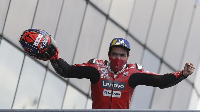 Italian rider Danilo Petrucci of the Ducati Team celebrates on the podium after winning the MotoGP race of the French Motorcycle Grand Prix at the Le Mans racetrack, in Le Mans, France, Sunday, Oct. 11, 2020. (AP Photo/David Vincent)