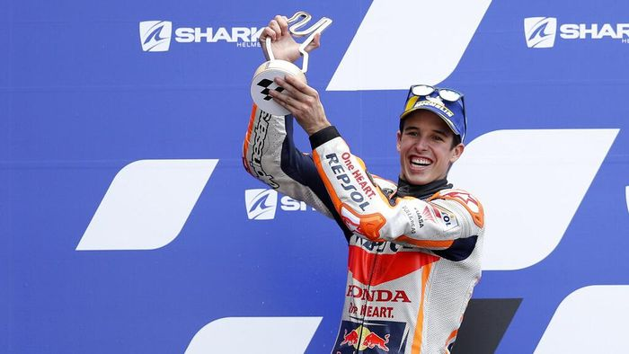 Second placed Spains rider Alex Marquez of the Repsol Honda Team celebrates with trophy on the podium after the MotoGP race of the French Motorcycle Grand Prix at the Le Mans racetrack, in Le Mans, France, Sunday, Oct. 11, 2020. (AP Photo/David Vincent)