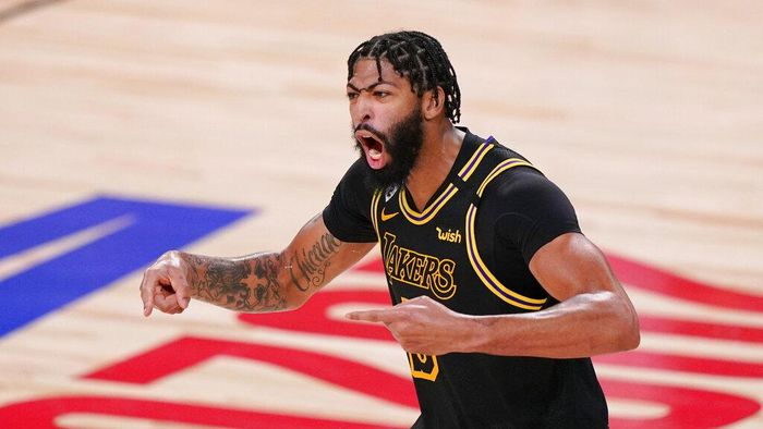Los Angeles Lakers forward Anthony Davis celebrated during the second half in Game 5 of basketballs NBA Finals against the Miami Heat Friday, Oct. 9, 2020, in Lake Buena Vista, Fla. (AP Photo/Mark J. Terrill)
