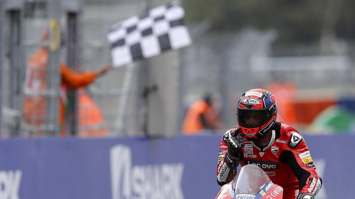 Italian rider Danilo Petrucci of the Ducati Team celebrates after winning the MotoGP race of the French Motorcycle Grand Prix at the Le Mans racetrack, in Le Mans, France, Sunday, Oct. 11, 2020. (AP Photo/David Vincent)