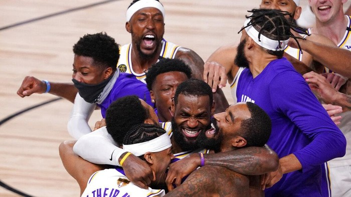 Los Angeles Lakers LeBron James (23) celebrates with his teammates after the Lakers defeated the Miami Heat 106-93 in Game 6 of basketballs NBA Finals Sunday, Oct. 11, 2020, in Lake Buena Vista, Fla. (AP Photo/Mark J. Terrill)