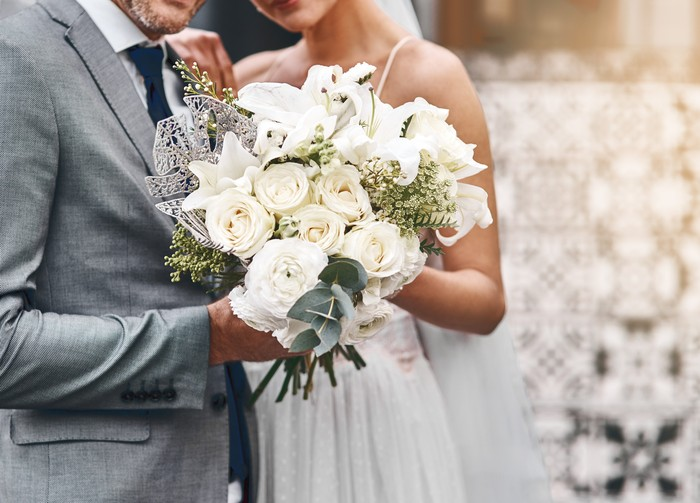 Cropped shot of an unrecognizable bride and groom standing together