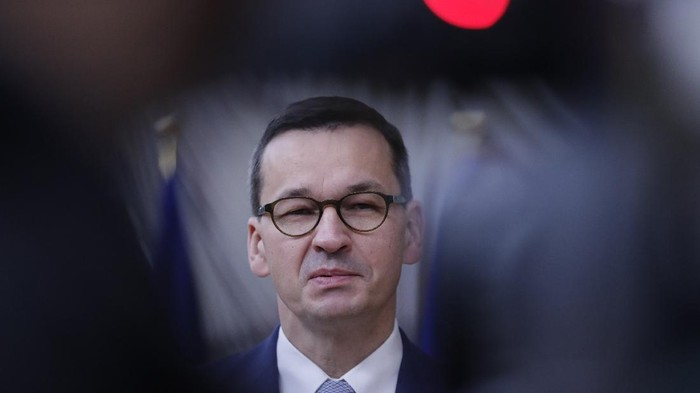 Polands Prime Minister Mateusz Morawiecki speaks on camera as he arrives for an EU summit at the European Council building in Brussels, Friday, Oct. 2, 2020. European Union leaders will be assessing the state of their economy and the impact of the coronavirus pandemic on it during their final day of a summit meeting. (Olivier Hoslet, Pool via AP)