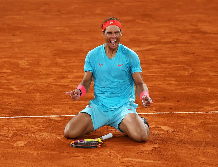 PARIS, FRANCE - OCTOBER 11: Rafael Nadal of Spain celebrates after winning championship point during his Mens Singles Final against Novak Djokovic of Serbia on day fifteen of the 2020 French Open at Roland Garros on October 11, 2020 in Paris, France. (Photo by Julian Finney/Getty Images)