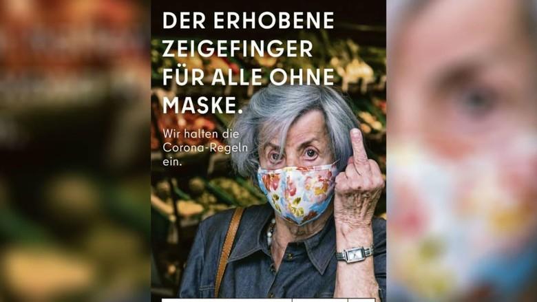 Iklan acungkan jari tengah Berlin