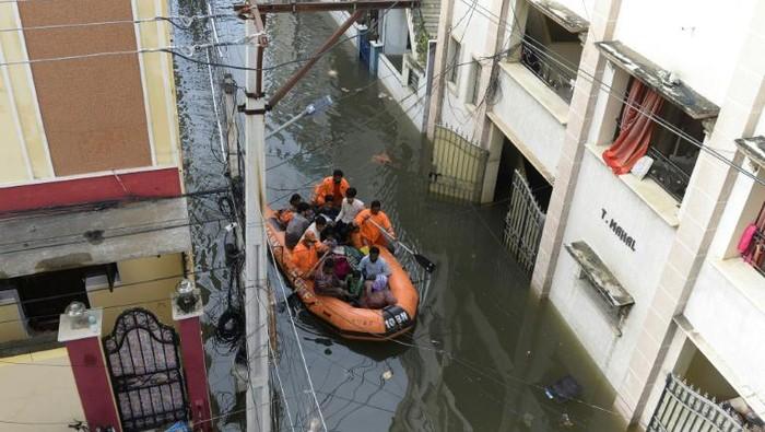 India selatan diguyur hujan lebat dan bajir (AFP Photo)