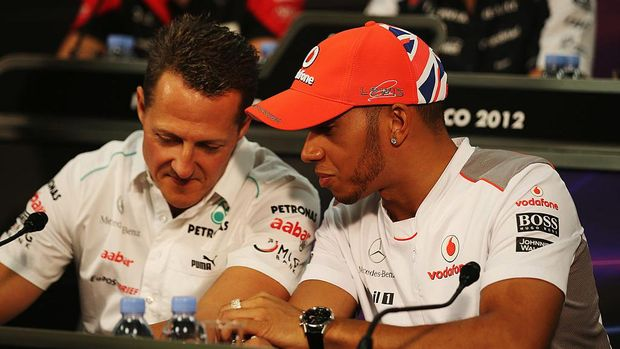 MONTE CARLO, MONACO - MAY 23:  Lewis Hamilton (R) of Great Britain and McLaren talks with Michael Schumacher (L) of Germany and Mercedes GP at the drivers press conference during previews to the Monaco Formula One Grand Prix at the Monte Carlo Circuit on May 23, 2012 in Monte Carlo, Monaco.  (Photo by Clive Mason/Getty Images)