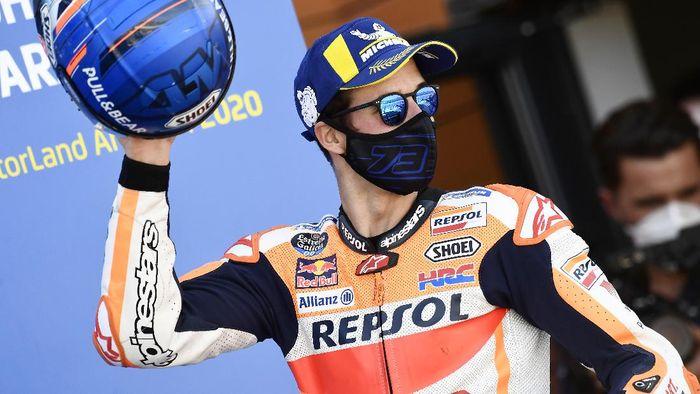 Honda rider Alex Marquez, of Spain, celebrates on the podium his third place in the Aragon Motorcycle Grand Prix at the Motorland circuit in Alcaniz, Spain, Sunday, Oct. 18, 2020. (AP Photo/Jose Breton)