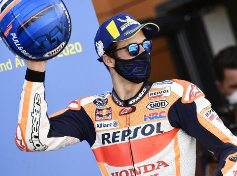 Honda rider Alex Marquez, of Spain, celebrates on the podium his third place in the Aragon Motorcycle Grand Prix at the Motorland circuit in Alcaniz, Spain, Sunday, Oct. 18, 2020. (AP Photo/Jose Breton)