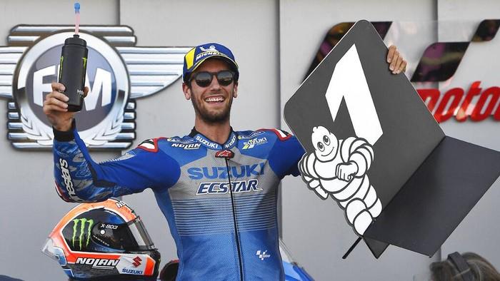 Suzuki rider Alex Rins, of Spain, celebrates after winning the Aragon Motorcycle Grand Prix at the Motorland circuit in Alcaniz, Spain, Sunday, Oct. 18, 2020. (AP Photo/Jose Breton)
