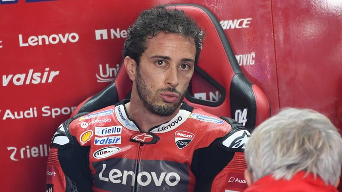 ALCANIZ, SPAIN - OCTOBER 16:  Andrea Dovizioso of Italy and Ducati Team  speaks  in box during the free practice for the MotoGP of Aragon at Motorland Aragon Circuit on October 16, 2020 in Alcaniz, Spain. (Photo by Mirco Lazzari gp/Getty Images)