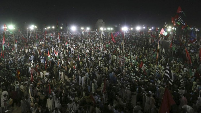 Supporters of the Pakistan Democratic Movement take part in an anti government rally in Karachi, Pakistan, Sunday, Oct. 18, 2020. Protests took place in a campaign against Prime Minister Imran Khan to force him step down over what they say is his failure in handling the nations ailing economy. (AP Photo/Fareed Khan)