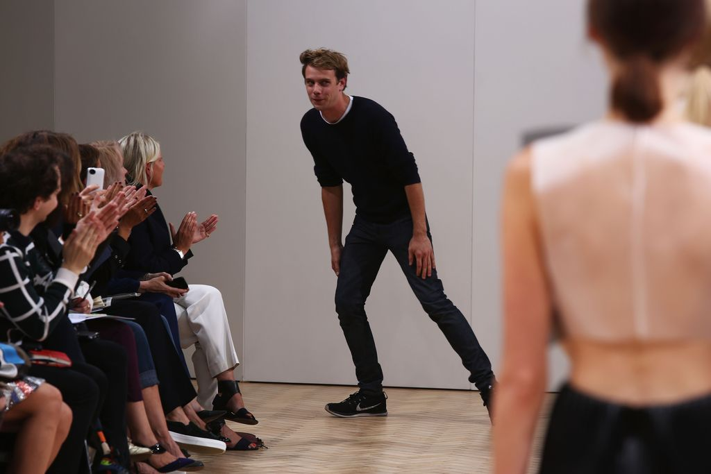 LONDON, ENGLAND - SEPTEMBER 14:  Designer J.W. Anderson acknowledges the audience after the J.W. Anderson show during London Fashion Week SS14 on September 14, 2013 in London, England.  (Photo by Tim P. Whitby/Getty Images)