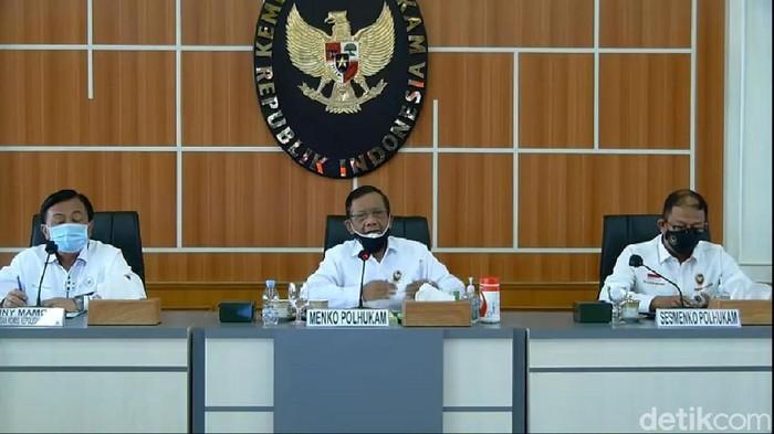 Menko Polhukam Mahfud Md membacakan hasil investigasi TGPF terkait rentetan penembakan di Intan Jaya (YouTube Kemenko Polhukam)