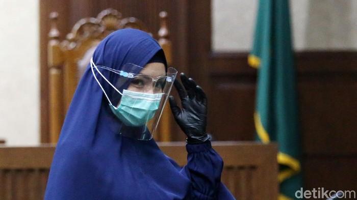Jaksa Pinangki Sirna Malasari menjalani sidang lanjutan di PN Tipikor Jakarta, Rabu (21/10/2020). Pinangki tampak berbusana muslim syari.