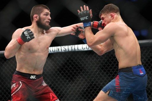 NEW YORK, NY - APRIL 07: Khabib Nurmagomedov (L) lands a left hand to the head of Al Iaquinta (R) during their UFC lightweight championship bout at UFC 223 at Barclays Center on April 7, 2018 in New York City.   Ed Mulholland/Getty Images/AFP