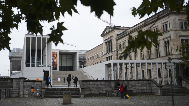 The main entrance to the Museums Island and the Neue Museum, left, in Berlin, Wednesday, Oct. 21, 2020. A large number of art works and artifacts at some of Berlins best-known museums were smeared with a liquid by an unknown perpetrator or perpetrators earlier this month, police said Wednesday. The numerous works in several museums at the Museum Island complex, a UNESCO world heritage site in the heart of the German capital that is one of the citys main tourist attractions, were targeted between 10 a.m. and 6 p.m. on Oct. 3, police said. (AP Photo/Markus Schreiber)