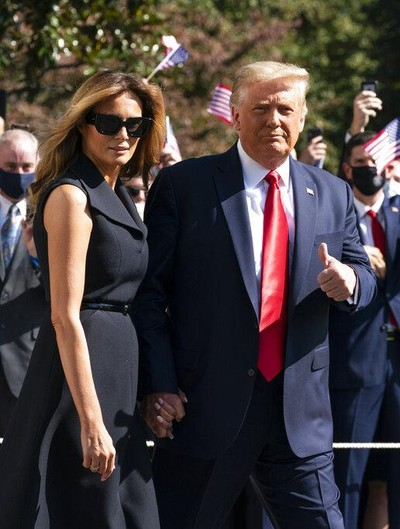 President Donald Trump and first lady Melania Trump walk to board Marine One on the South Lawn of the White House, Thursday, Oct. 22, 2020, in Washington. Trump is headed to Nashville, Tenn., for a debate. (AP Photo/Alex Brandon)