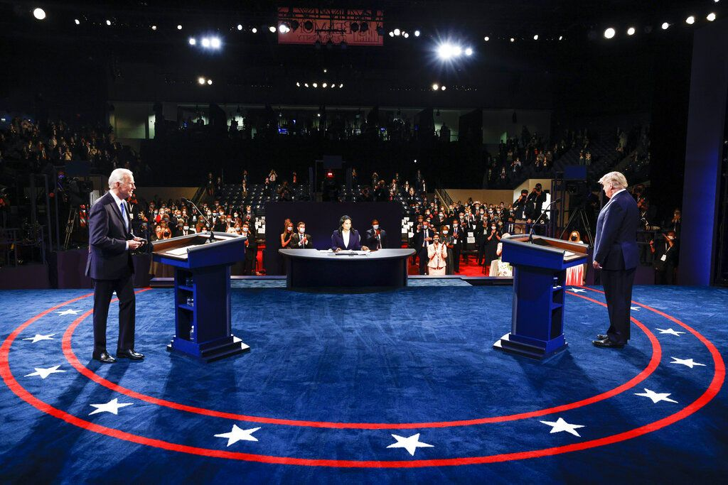 Democratic presidential candidate former Vice President Joe Biden points toward President Donald Trump during the second and final presidential debate Thursday, Oct. 22, 2020, at Belmont University in Nashville, Tenn. (AP Photo/Morry Gash, Pool)
