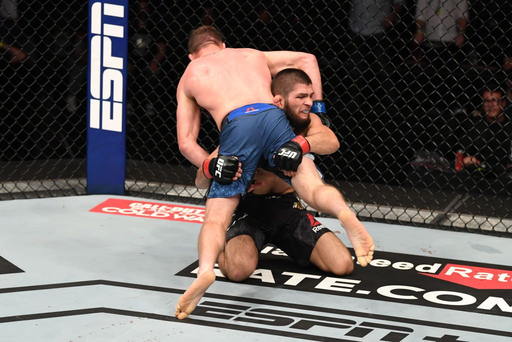 ABU DHABI, UNITED ARAB EMIRATES - OCTOBER 25:  In this handout image provided by UFC, (R-L) Khabib Nurmagomedov of Russia takes down Justin Gaethje in their lightweight title bout during the UFC 254 event on October 25, 2020 on UFC Fight Island, Abu Dhabi, United Arab Emirates. (Photo by Josh Hedges/Zuffa LLC via Getty Images)