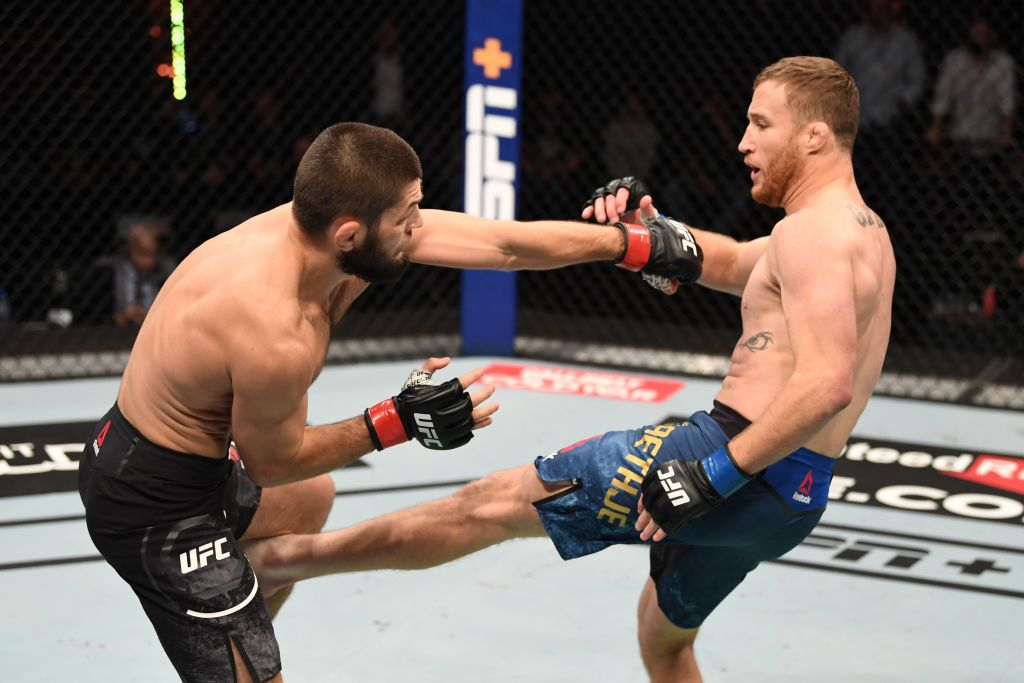 ABU DHABI, UNITED ARAB EMIRATES - OCTOBER 25: In this handout image provided by UFC, (R-L) Justin Gaethje kicks Khabib Nurmagomedov of Russia in their lightweight title bout during the UFC 254 event on October 25, 2020 on UFC Fight Island, Abu Dhabi, United Arab Emirates. (Photo by Josh Hedges/Zuffa LLC via Getty Images)