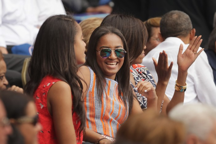 HAVANA, CUBA - MARCH 22:  (L-R) Malia Obama, Sasha Obama, U.S. first lady Michelle Obama and President Barack Obama react to the first run scored during an exhibition game between the Cuban national baseball team and Major League Baseballs Tampa Bay Devil Rays at the Estado Latinoamericano March 22, 2016 in Havana, Cuba. This is the first time a sittng president has visited Cuba in 88 years.  (Photo by Chip Somodevilla/Getty Images)