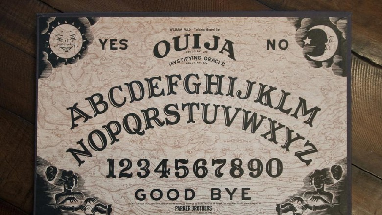 Bedford, NH USA - May 11, 2012: Ouija Board by Parker Brothers on wooden table