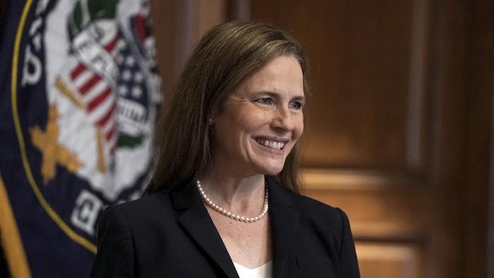 Supreme Court nominee Amy Coney Barrett, meets with Sen. Martha McSally, R-Ariz., Wednesday, Oct. 21, 2020, on Capitol Hill in Washington. (Greg Nash/Pool via AP)